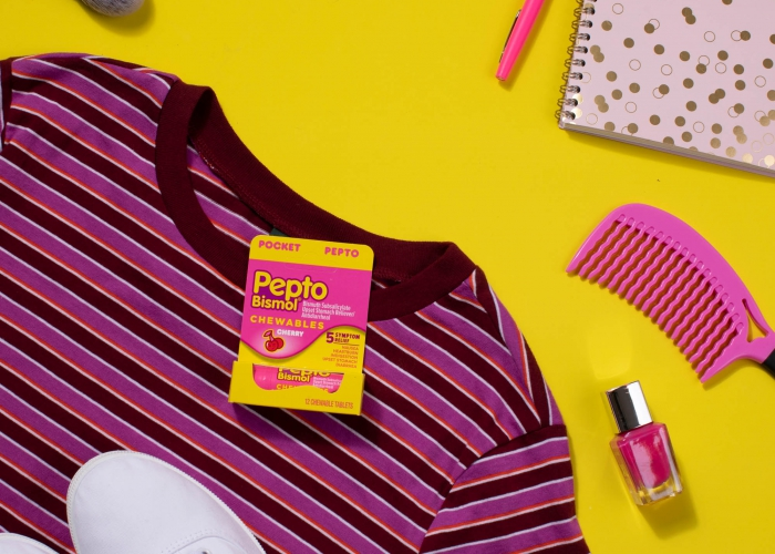 pesto bismol chewable flat lay with shirt and shoes - p&g product photography