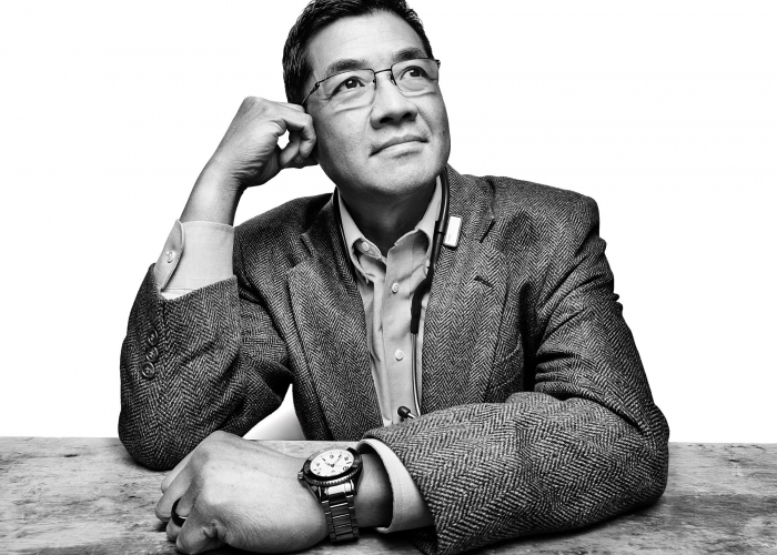 Portrait of a professional man sitting a table - black and white